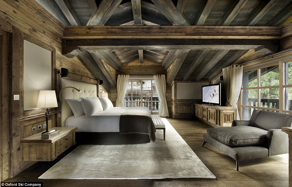 Comfortable: Each of the vast bedrooms comes with stunning Alpine views and an equally gargantuan plasma screen TV and day bed
