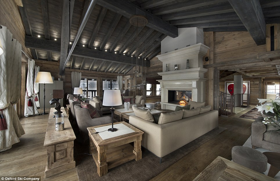 Luxury: Chalet Eidelweiss boasts a chic neutral colour scheme throughout, stunning views of the mountains and has roaring open fires tended by permanent staff