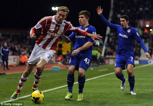 In action: Clancy's partner, Stoke City striker Peter Crouch, takes the ball past Cardiff defender Declan John