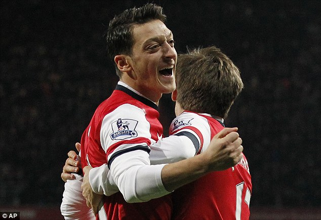 Because he's worth it: Arsenal's Mesut Ozil is congratulated by Nacho Monreal following his strike against Hull
