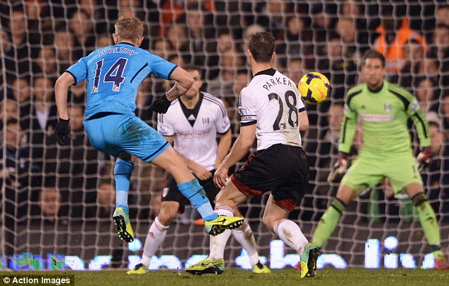 Pick that one out! Lewis Holtby thunders a shot towards the Fulham goal to score Tottenham's winner