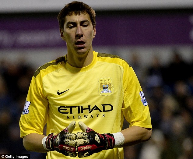 Dedicated follower of fashion: Man City keeper Costel Pantilimon followed Mathieu Flamini's lead and wore short sleeves against West Brom