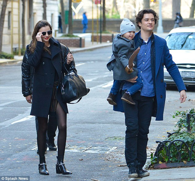 For the sake of Flynn: Miranda and Orlando's split is amicable, and the parents have remained close for the sake of their son Flynn