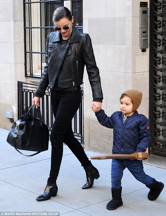 Her little man: Miranda and Flynn stepped out for a mother and son stroll over the weekend