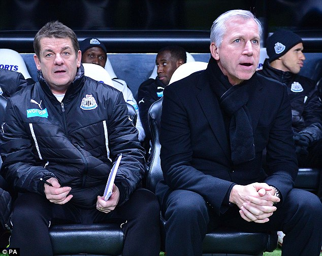 Scary: Newcastles United manager Alan Pardew (right) and his assistant John Carver (left) endured a difficult flight back to Newcastle following the 3-0 defeat at the Liberty Stadium