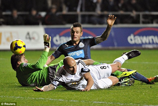 Heavy landing: After losing 3-0 away at Swansea the Newcastle squad faced a turbulent flight back home