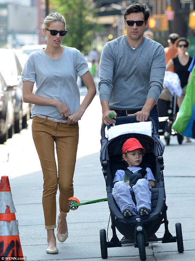 Rolling and strolling: Karolina fits her busy career around husband Archie Drury and their little boy Tobin, pictured here in New York's Tribeca neighbourhood in June