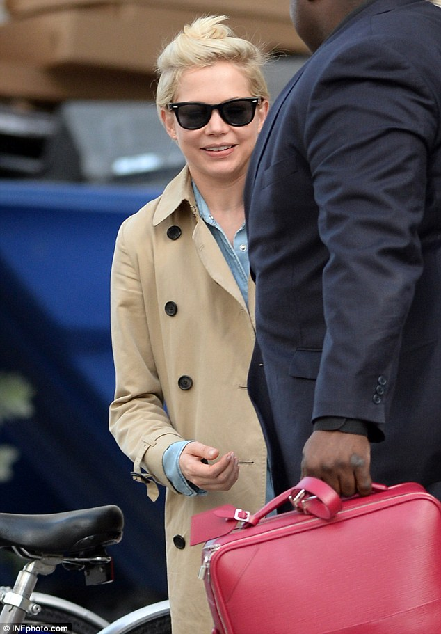 Cute and casual: The star pulled her short blonde hair back into a high top knot and shielded her eyes with black shades