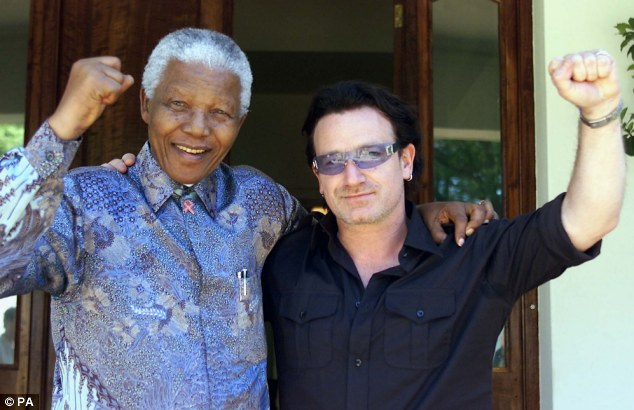 Friends: U2 front man Bono, with Mandela at his Johannesburg home in 2002, is thought to have been invited