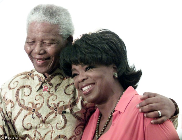 Star-studded event: The memorial service is expected to draw many celebrities who had a personal relationship with Mandela, including Oprah Winfrey pictured here in 2002