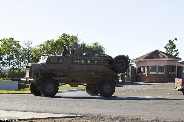 Soldiers guard Mandela's home in Qunu, where he will be laid to rest in accordance with his final wishes at a service on Sunday, December 15