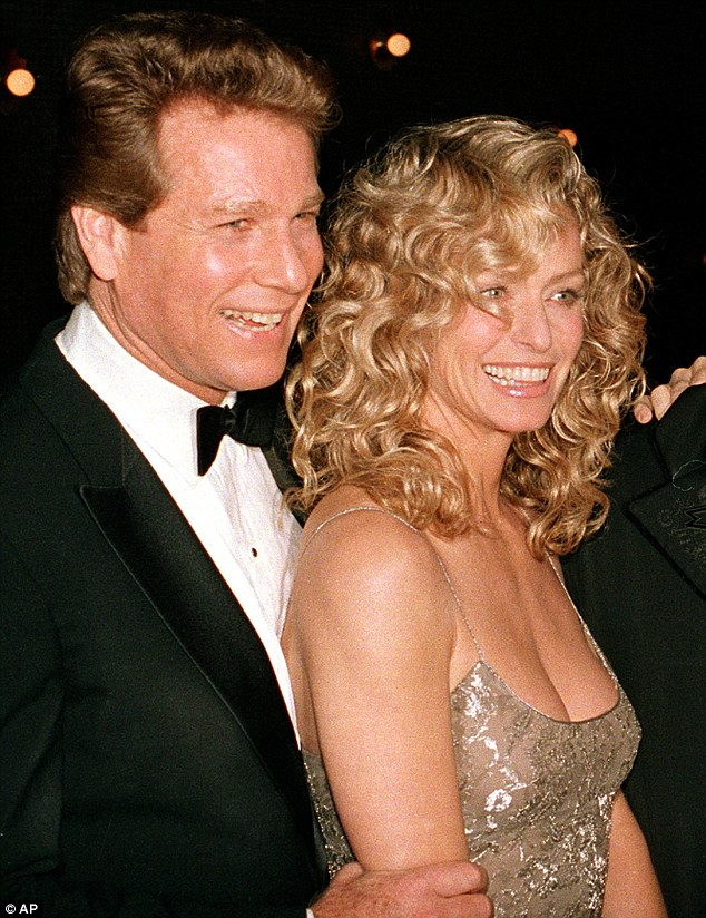 Rocky romance: Ryan O'Neal, shown with the late Farrah Fawcett in 1989, had a stormy relationship with the actress