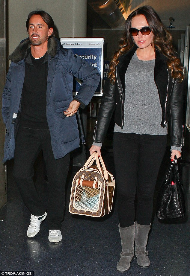 Happy family: Tamara Ecclestone looked chic as she arrived with her man Jay Rutland and her new pooch on Thursday