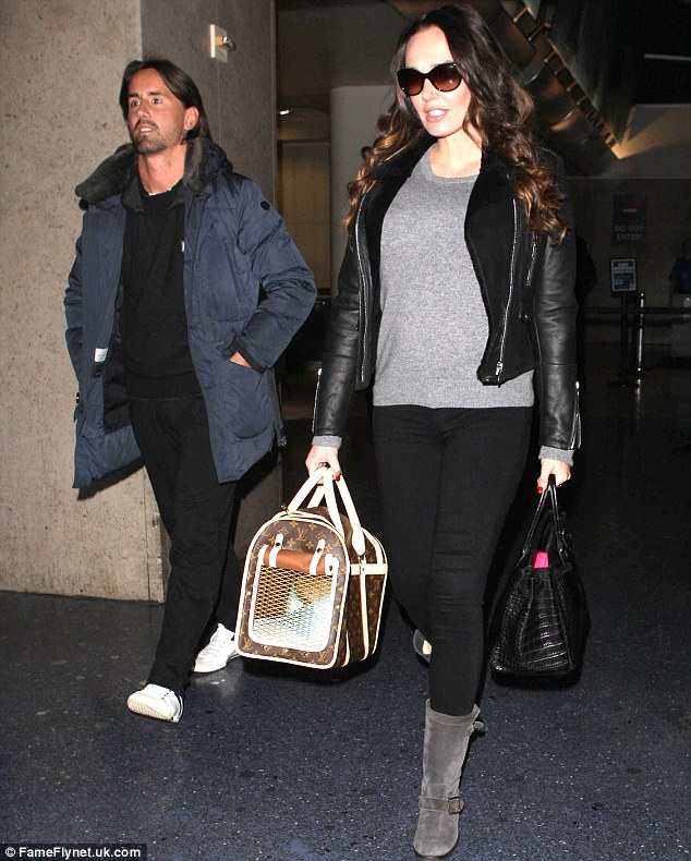 Wrapped up warm: The married couple both wore warm clothes for their arrival