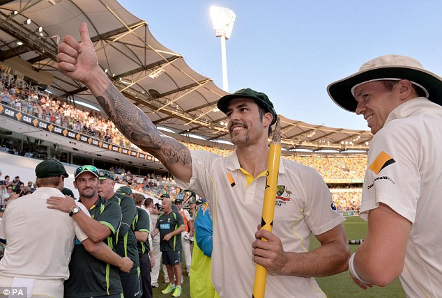 Thumbs up: Johnson celebrates after Australia wrapped up a comfortable win against England in Brisbane