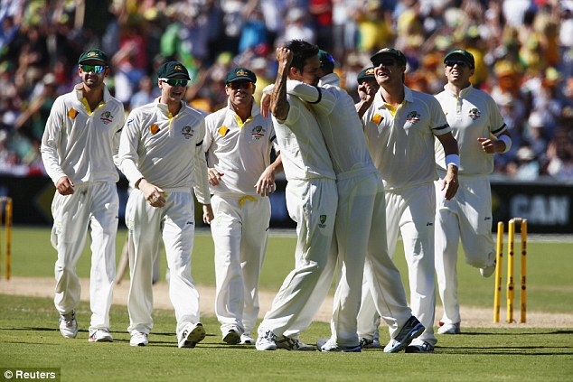 Changed days: Australia celebrate after Mitchell Johnson bowls out Alastair Cook on day two