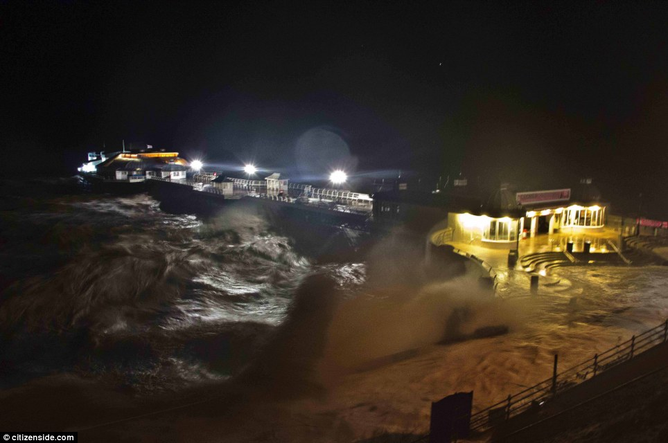 Overwhelming power: Waves lash the promenade and pier in Cromer, Norfolk on Thursday night