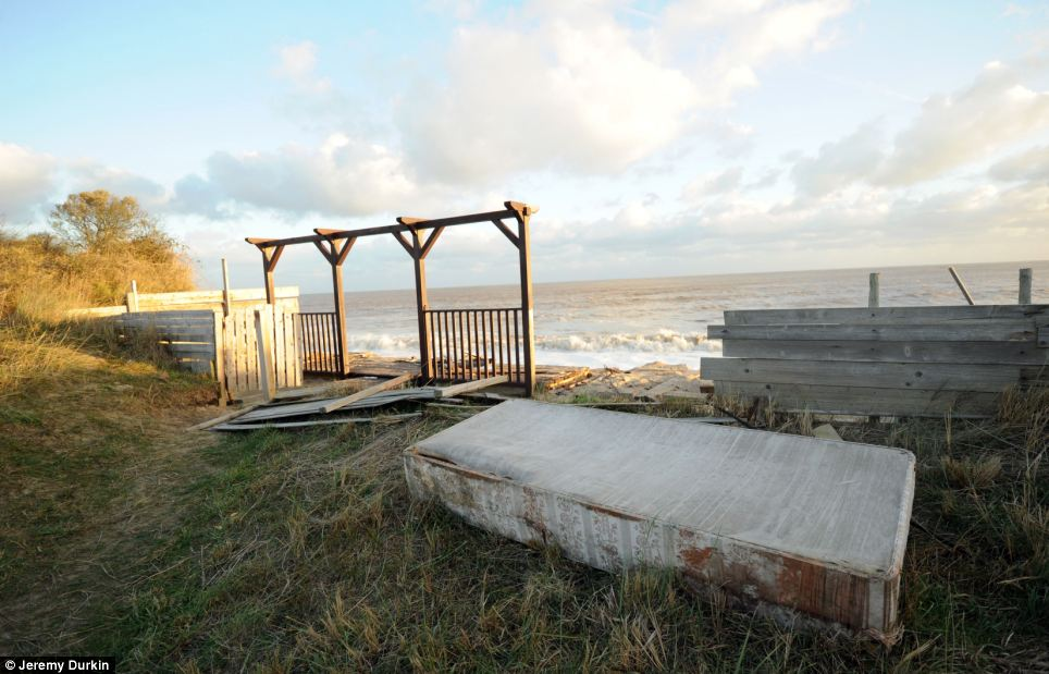 A building has almost completely disappeared after it was swept into the sea during the storm surge