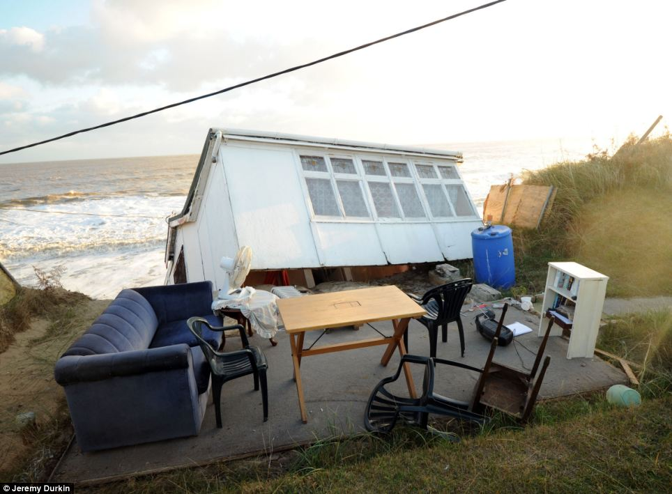 The homes fell into the sea after the cliffs collapsed during the storm which battered the east coast of Britain during the night