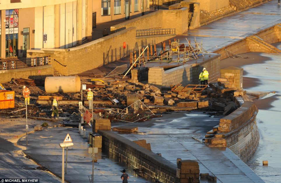 Workers assess the damage caused by the sea to Scarborough Foreshore, at North Bay, in Scarborugh