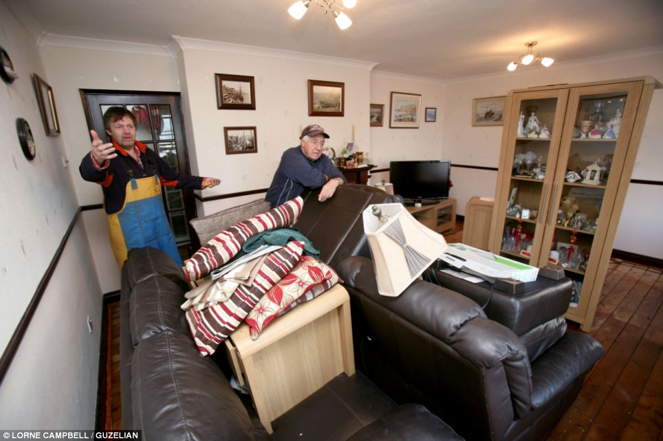 In Whitby, North Yorkshire, Robert Cole has begun his personal clean-up after his home was flooded yesterday