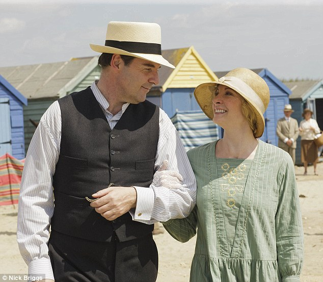 Happy couple: Bates and Anna prove they're stronger than ever as they hit the beach following his wife's rape in the last series