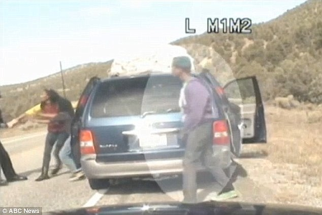 That's it: Having seen enough, the teen jumps out of the car to confront the officer