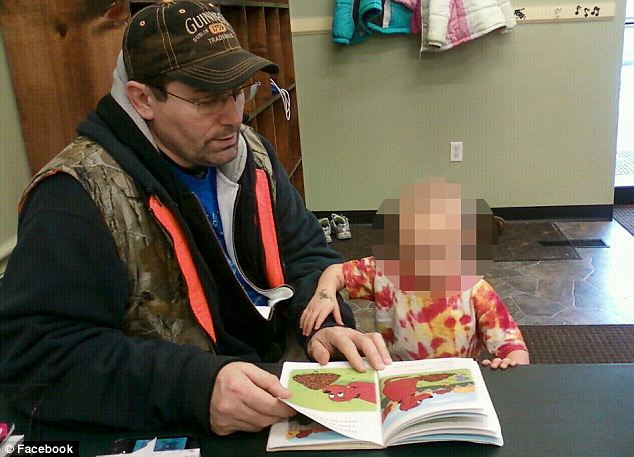 Suspect: Randy Keith, 53, pictured here with one of his young children who is now an orphan