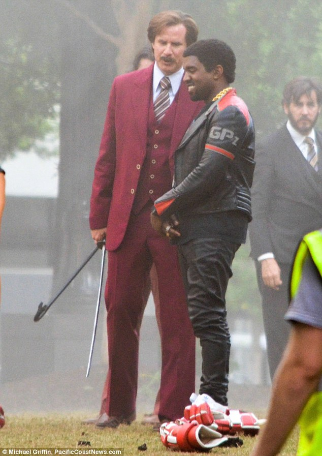 Keeping him happy: Will Ferrell has explained that he kept Kanye West happy on the set of Anchorman 2 by listening to his music when the rapper came to film his cameo role