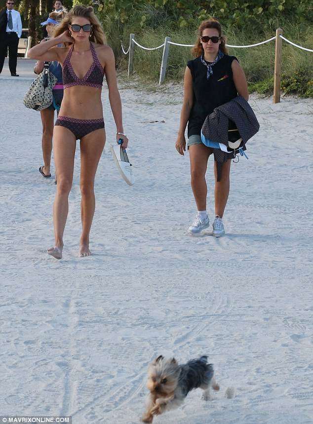 Doggie day care: Jessica's pet dog Floyd looked to be having a great time running around on the beach