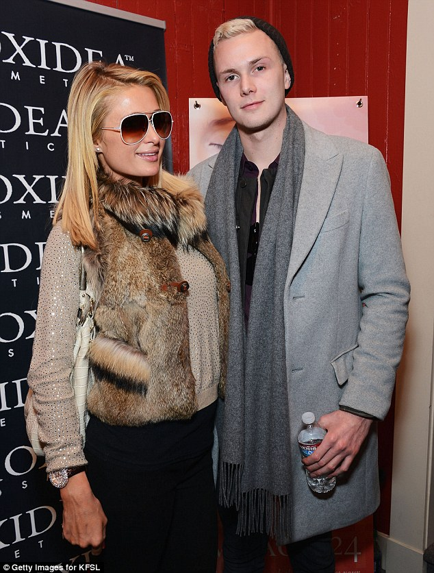 Thicker than water: Paris Hilton has vowed to make Lindsay Lohan pay for allegedly 'masterminding' an attack in Miami, Florida, on her brother Barron, seen here together in Utah earlier this year