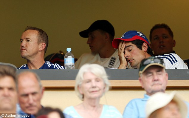 Oh no: England's captain Alastair Cook and team director Andy Flower look on from the dressing room