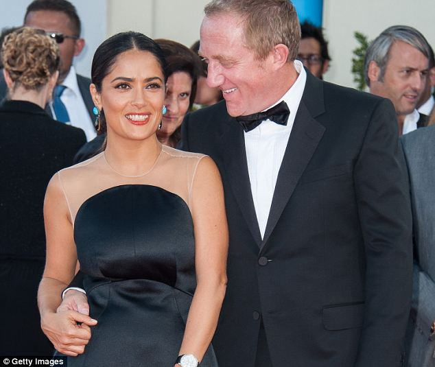 Salma Hayek and husband Francois-Henri Pinault, pictured last year. The pair are reportedly searching for a family home in London, sparking speculation that they are set to join 'l'exodus' of wealthy French fleeing high taxes