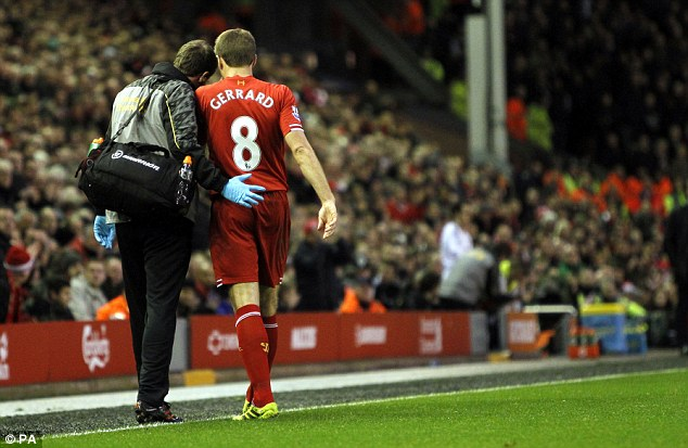 Helping hand: Gerrard is helped as he limps off the pitch during Liverpool's win over the Hammers