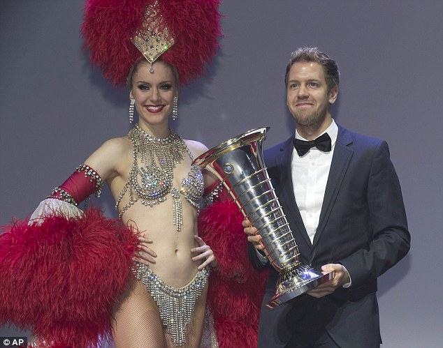 Double or quits: Sebastian Vettel, seen here collecting his 2013 winner's trophy, has won four titles on the spin