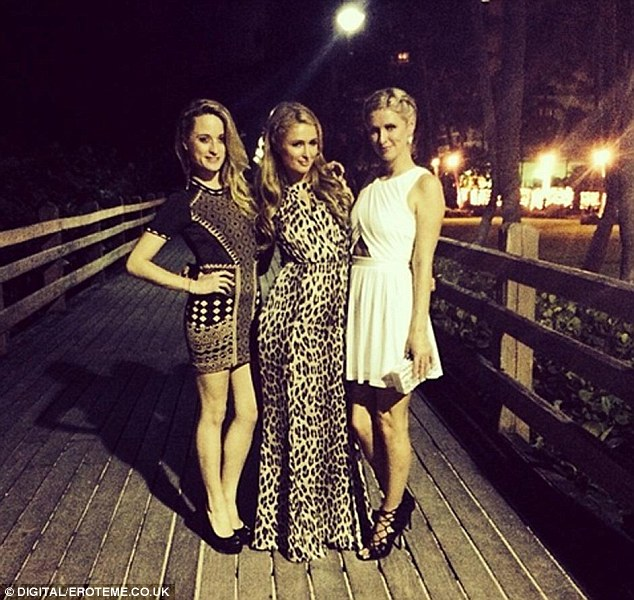 Blonde ambition: Paris donned an animal-print dress as she posed with sister Nicky and a friend the previous night