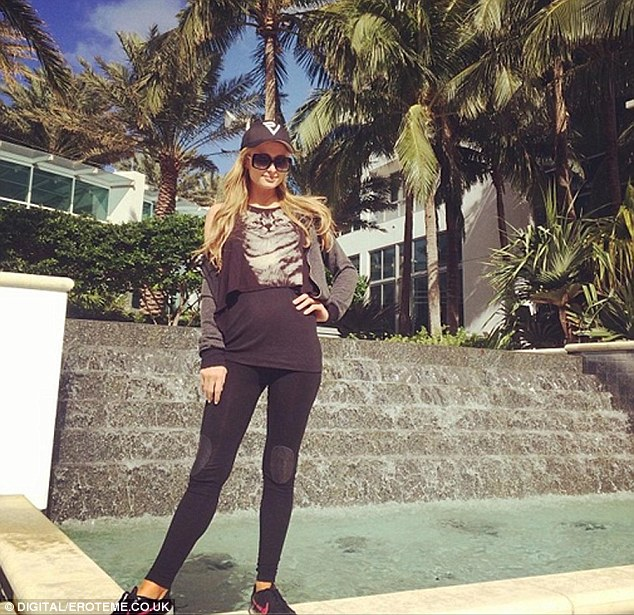 Adieu: Paris posed next to a water feature at the Fontainebleau Resort in Miami before heading to the airport