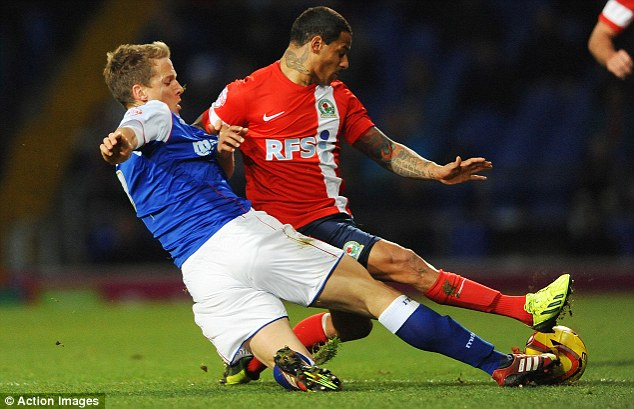 Arrested: Blackburn's DJ Campbell, in action against Ipswich Town last week, arrested in connection with the match-fixing scandal in December