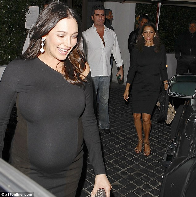 Hot mamas: Lauren's mother, also wearing a black dress, looked elegant in her slinky pumps as Simon looked on, clutching a pack of menthol cigarettes