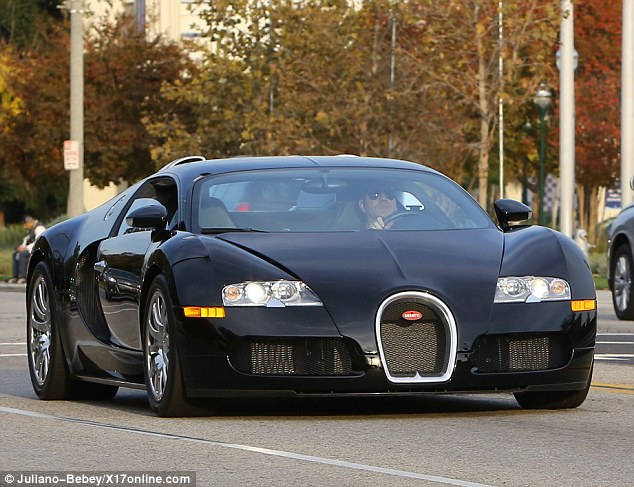 Conspicuous consumption: Cowell has driven this $1.7 million Bugatti sports car a total of three times. He took it for a spin while Lauren hosted her baby shower