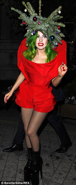 Feeling festive: Gaga headed home from the ball wearing a Christmas tree outfit