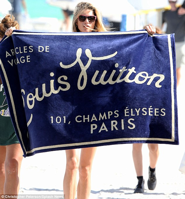 We get the point: The blonde beauty also showed off a rather large Louis Vuitton beach towel