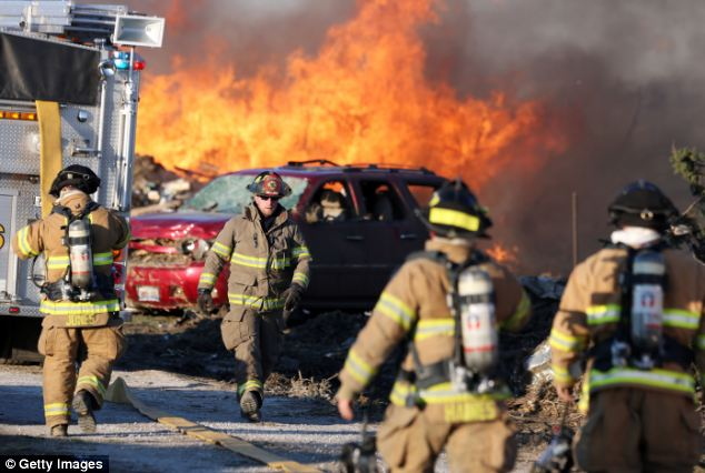 Firefighters battled a blaze in the aftermath of a Nov. 18 tornado in Washington, Illinois. The vast majority of U.S. firefighters are community volunteers
