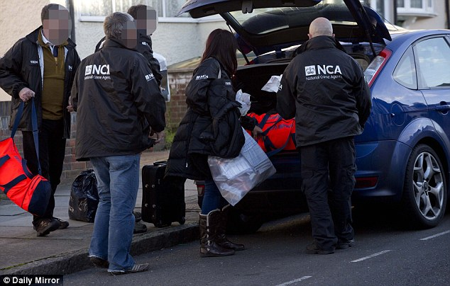 Investigation: Officers from the NCA remove documents and equipment from the home Stephen Sodje