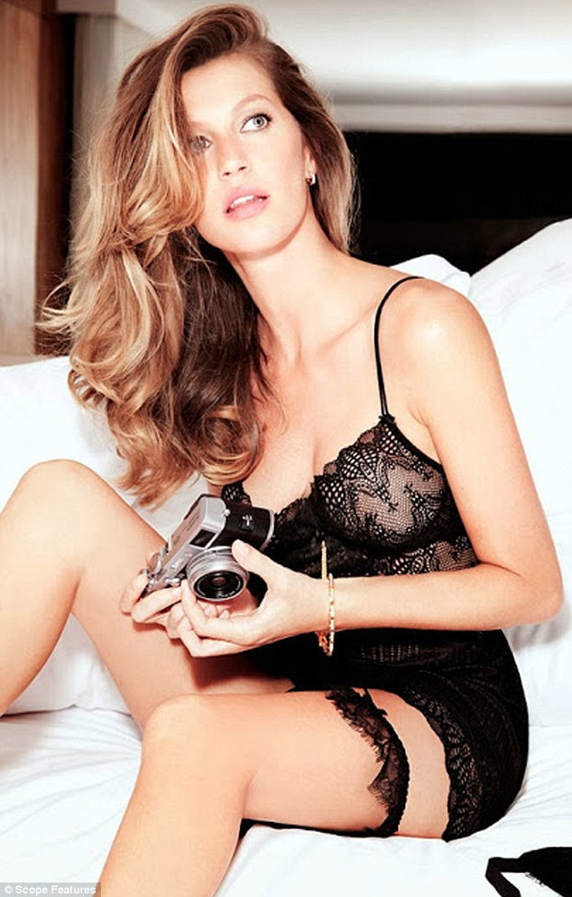 Wowzers: In the raciest of the three shots, Gisele is seen wearing a black lace garter and a near enough see-through black lace camisole