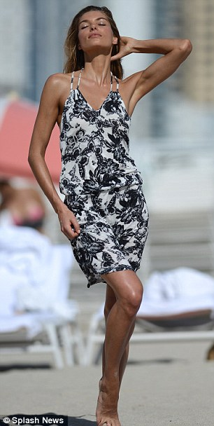 The black and white of it: Hart looked spectacular in a cute summer dress