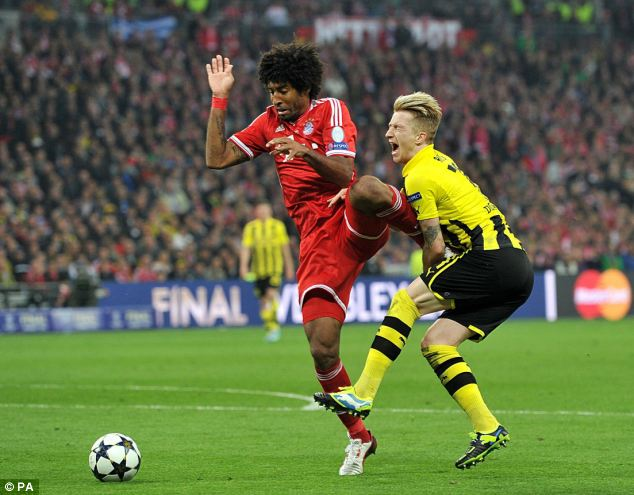 Sport: Perhaps surprisingly considering both teams were German, the UEFA Champions' League final at Wembley stadium beat the birth of Prince George to third place. Pictured: Bonfim Dante fouls Marco Reus