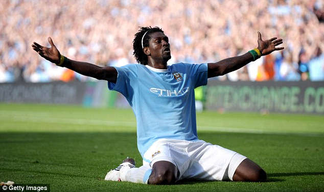 Bitter: Emmanuel Adebayor ran the length of the pitch to celebrate his Manchester City goal in front of Arsenal fans