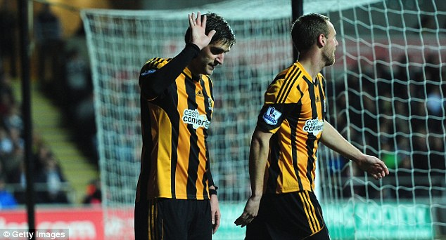 Sorry: Danny Graham (left) apologises to the Swansea fans after scoring against them for Hull