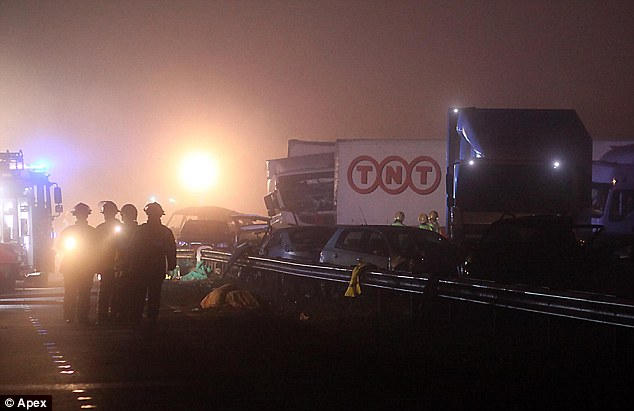 Pile-up: The emergency services consider the situation on the night that seven died and 51 were injured on the M5 in 2011